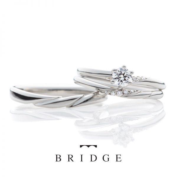 ゆきどけBRIDEG銀座の人気ランキング上位の結婚婚約のセットリング重なりが美しくアシンメトリー(アシメ)デザインはエンゲージマリッジ重なると新しいデザインに