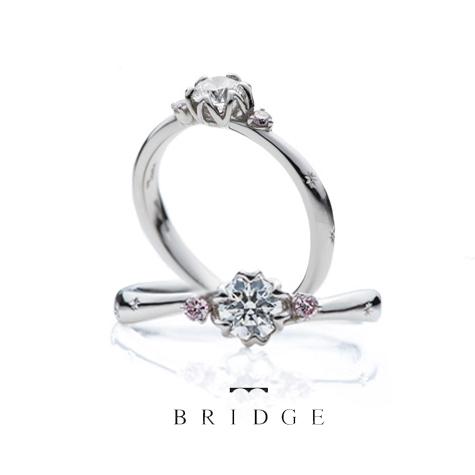 サイドのピンクダイヤがかわいい結婚指輪婚約リングの銀座ブリッジアントワープブリリアント