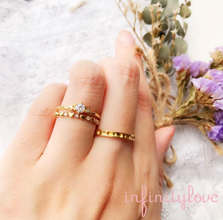 ハートがモチーフでゴールドが可愛い婚約指輪と結婚指輪のセットです。
