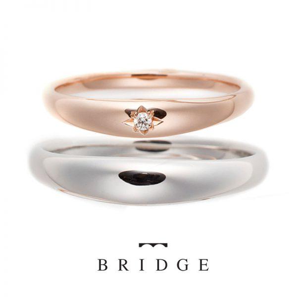 ふっくら柔らかいフォルムの結婚指輪フェミニンな印象で愛され花嫁にワンポイントダイヤモンドは職人技の彫り留でプチセレブで好印象に