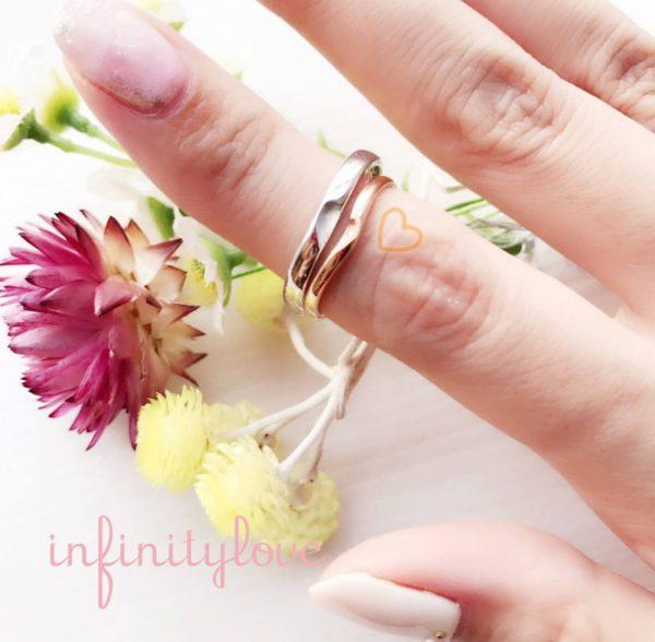 ふたりでひとつハートが出来るインフィニティラブの結婚指輪ピンクゴールド銀座ブリッジBRIDGE金色が可愛らしい