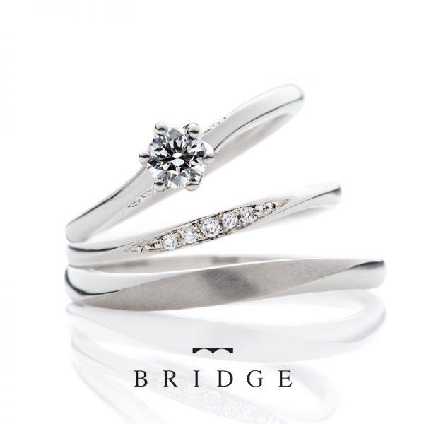シンプルで美しいウェーブラインブリッジボヤージュは、銀座で人気の婚約指輪と結婚指輪のセットリングです。