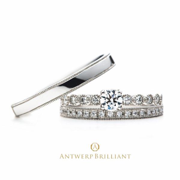 銀座で人気の結婚指輪と婚約指輪のブライダルリングのセレクトショップ、ブリッジ銀座アントワープブリリアントギャラリーが取り扱うブランド「AntwerpBrilliant」で人気のデザイン「D-Line Star Classic」3EXのメレダイヤモンドとミルグレイン加工が、アンティーク調でかわいく、さりげなく美しデザインとして人気です。男性用のマリッジリングはシンプルミルグレインがかっこよく人気があります。