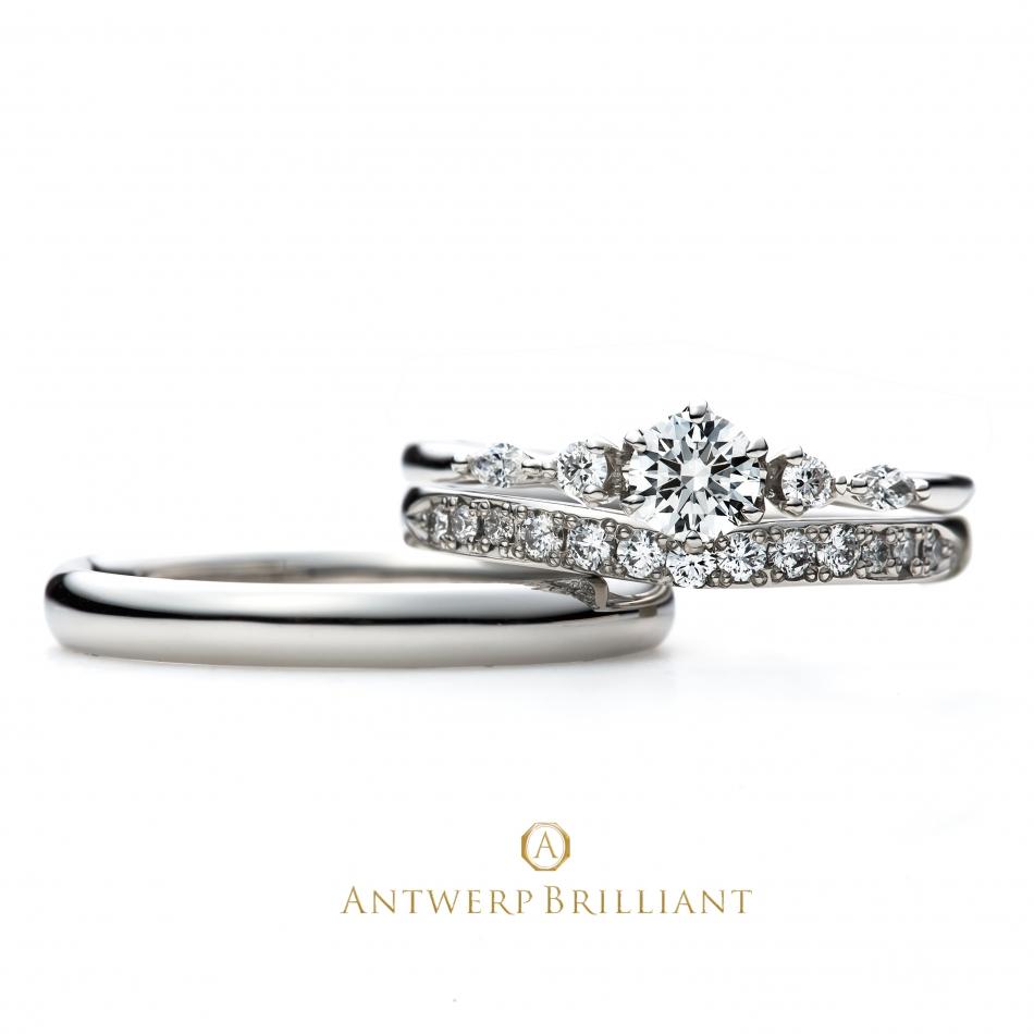 銀座で人気の結婚指輪と婚約指輪のブライダルリングのセレクトショップ、ブリッジ銀座アントワープブリリアントギャラリーが取り扱うブランド「Antwerpbrilliant」で人気のデザイン「FIVE STAR」ラウンドとマーキースカットを使った、大人可愛い上品なデザインのエンゲージリング。
