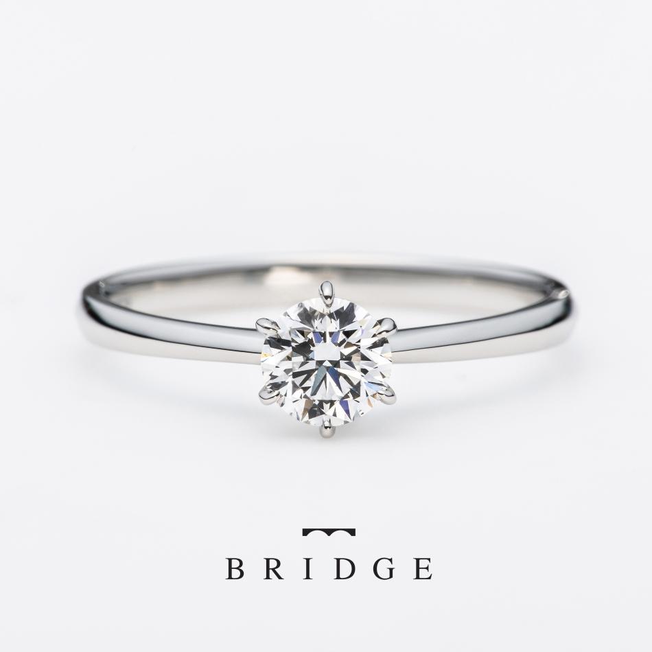 銀座で人気の結婚指輪と婚約指輪のブライダルリングのセレクトショップ、ブリッジ銀座アントワープブリリアントギャラリーが取り扱うブランド「BRIDGE」で人気のデザイン「一輪の薔薇(here&now」ダイヤモンドの輝きを楽しむために考えつくされた、「きシンプルなデザイン、プロポーズリングとしても人気の高いリングです。