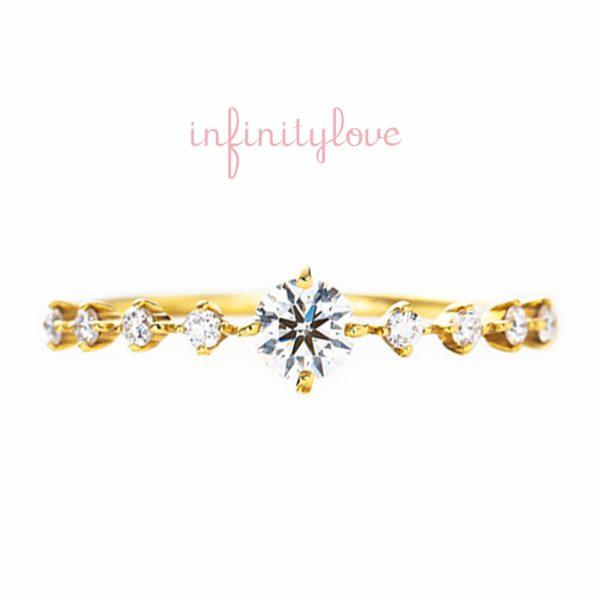 イエローゴールドの華奢で可愛いダイヤモンドの婚約指輪です
