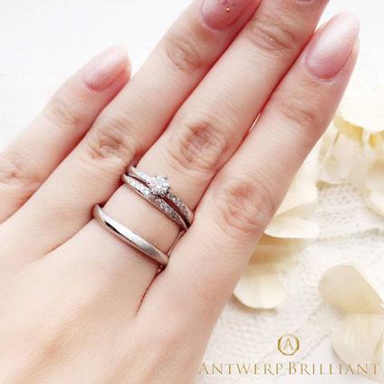 立体的なダイヤモンドウエーブラインの婚約結婚リングのセット重ねつけがかわいいアントワープ