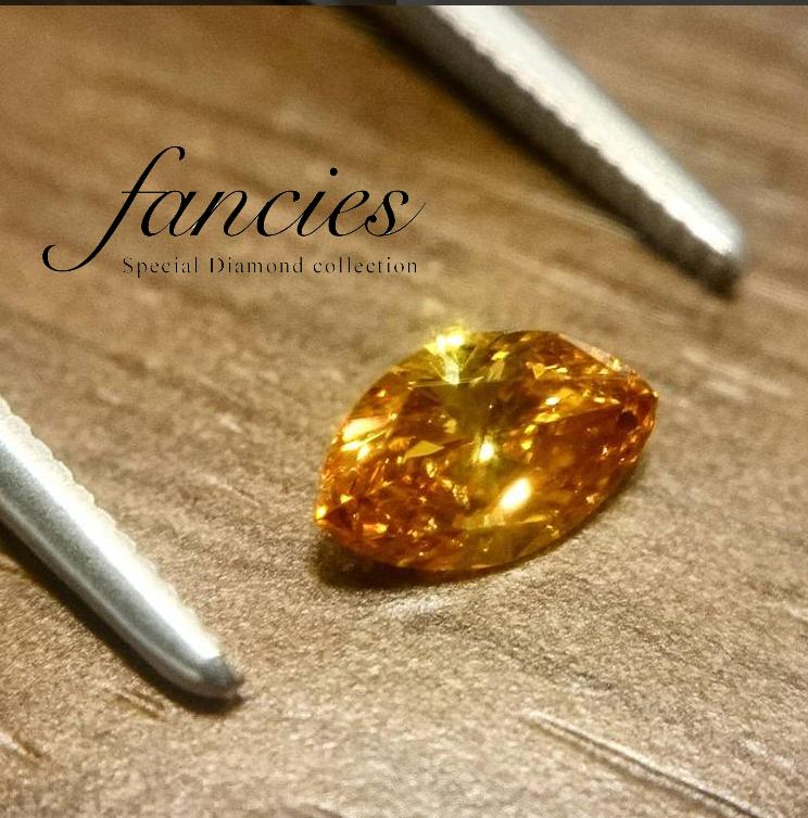 マーキースカットが美しいイエローオレンジのダイヤモンド