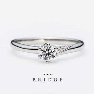 ゆきどけBRIDEG銀座の人気ランキング上位の婚約指輪のセットリング重なりが美しくアシンメトリー(アシメ)デザインはエンゲージマリッジ重なると新しいデザインに