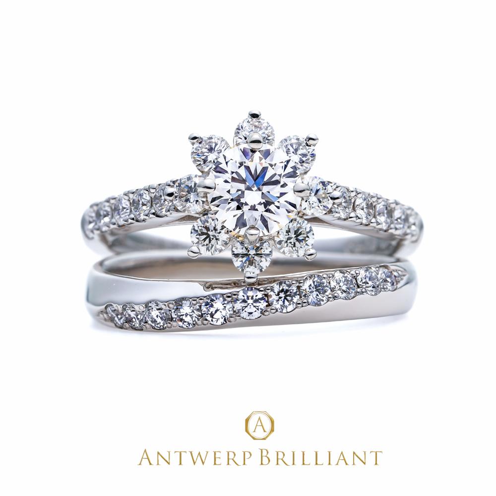 銀座で人気のAntwerpBrilliant ヘイローデザイン婚約指輪 StarShineと美しいダイヤモンドラインとプラチナの輝きが融合した華やかなデザイン結婚指輪 Cross Of Light