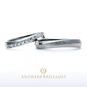 """Cross of light"" cross line diamond ring"